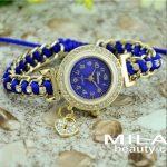 Нежен дамски часовник обсипан с полускъпоценни камъни и синя каишка